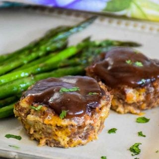 Keto Friendly BBQ Venison Meatloaf muffins on a plate with a side of asparagus