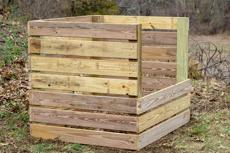 A pressure treated wood compost bin