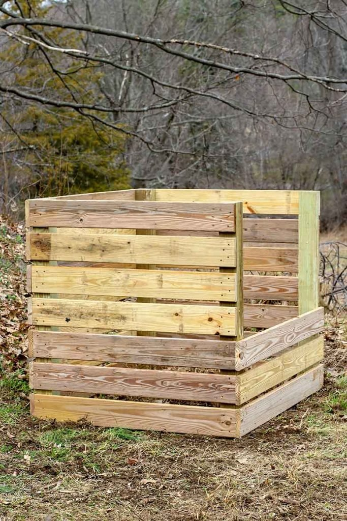 A pressure treated wood compost bin