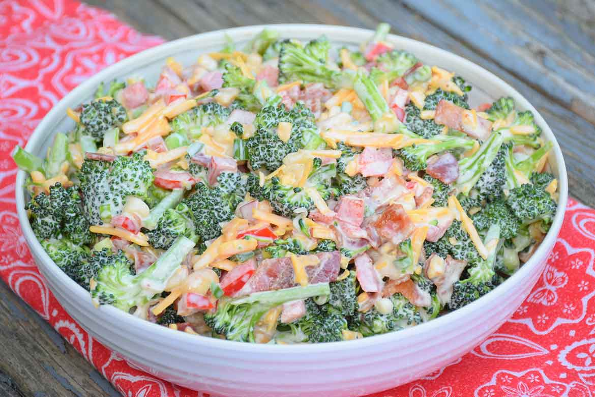 Keto Broccoli Salad in a white serving bowl on a red and white napkin