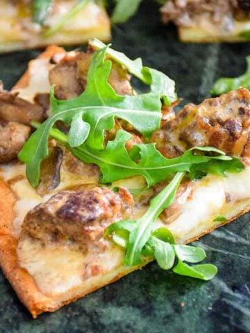 Venison Meatball Pizza with Alfredo Sauce and Arugula sliced