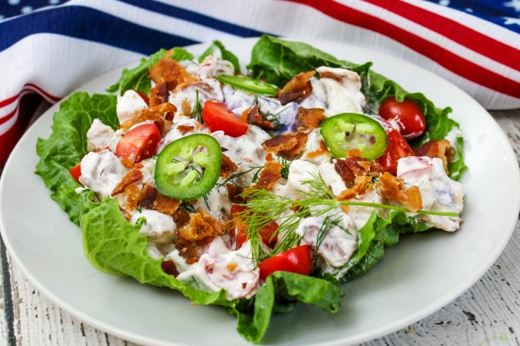 Potato Salad serving on a white plate with flag patterned napkin