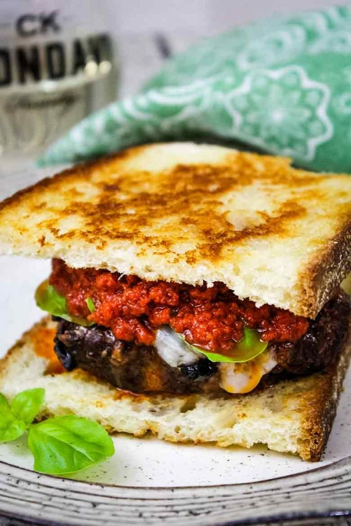Venison Burger Recipe Between toasted Tuscan Pane Bread with fresh basil and sun dried tomato aioli toppings