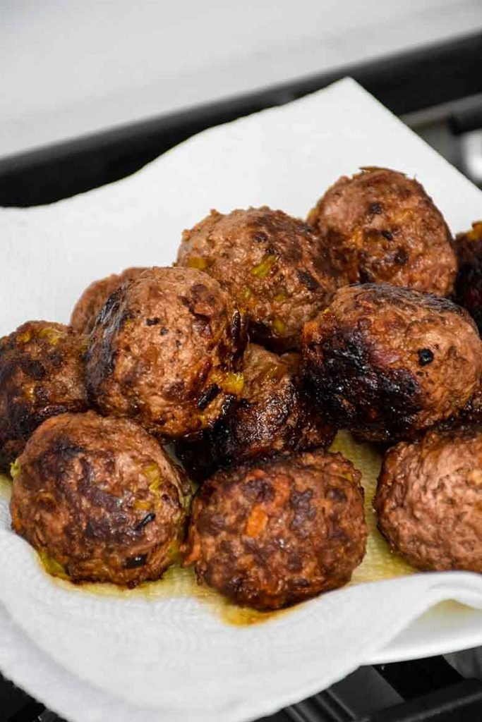 Venison meatballs on plate with paper towel beneath