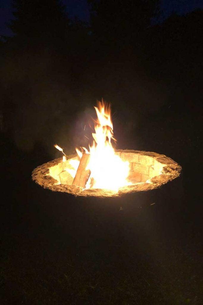 DIY Stone Fire Pit lit