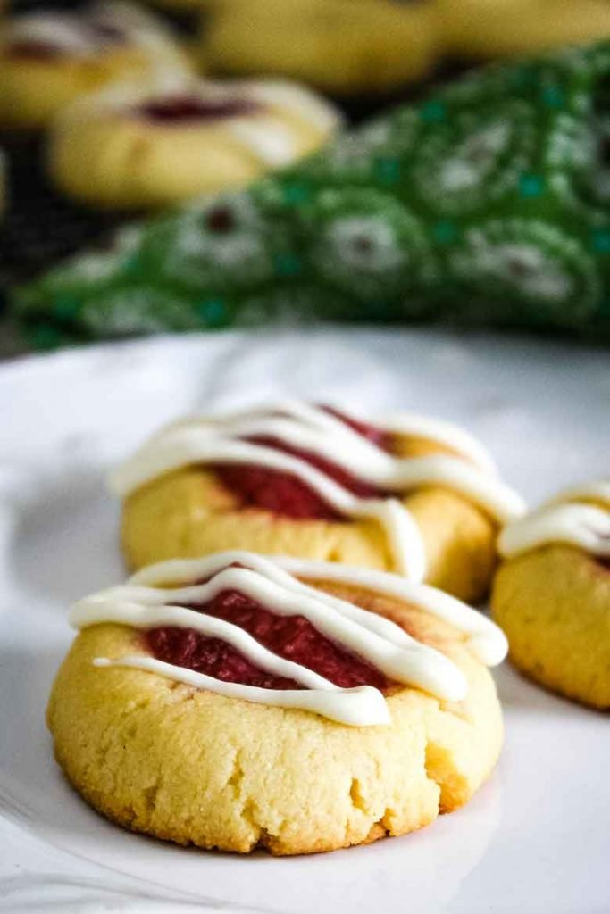 Strawberry Rhubarb Cookies drizzled with icing on a serving plate
