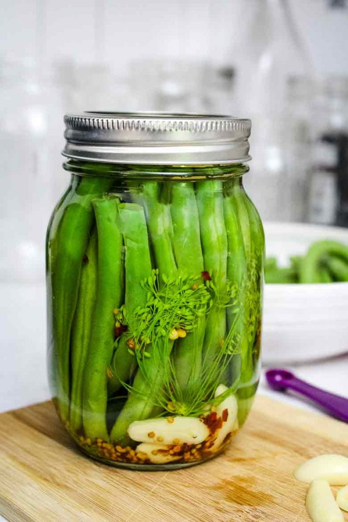 Pickled Green Beans also known as Dilly Beans in a pint jar
