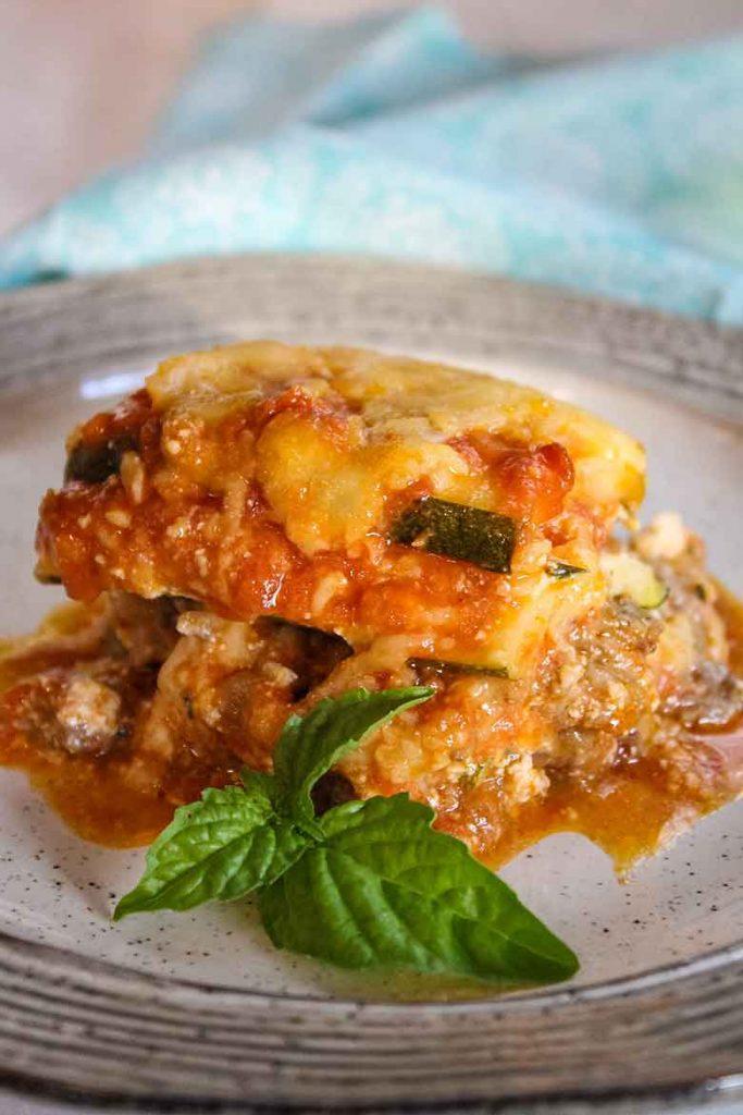 Keto Zucchini Lasagna on a plate with fresh basil garnish
