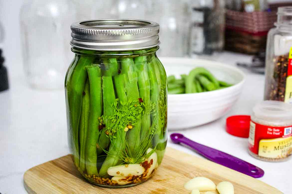a pint jar of pickled green beans after processing