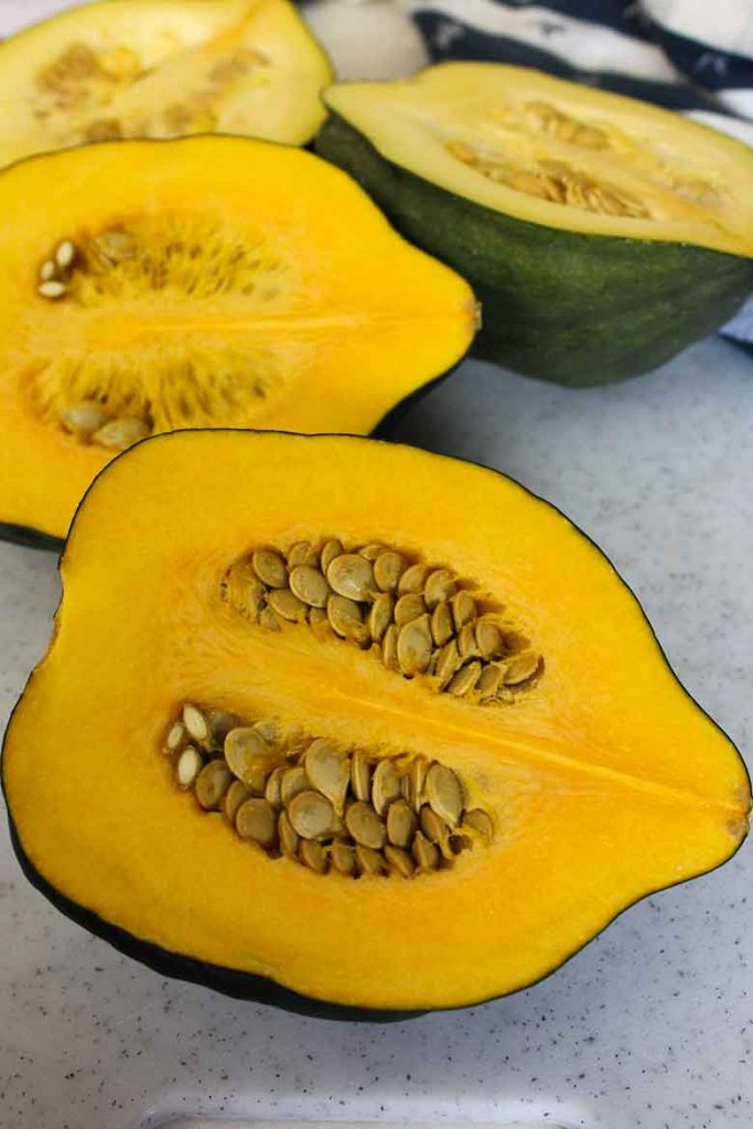 Butternut squash cut in half with the seeds and pulp still inside