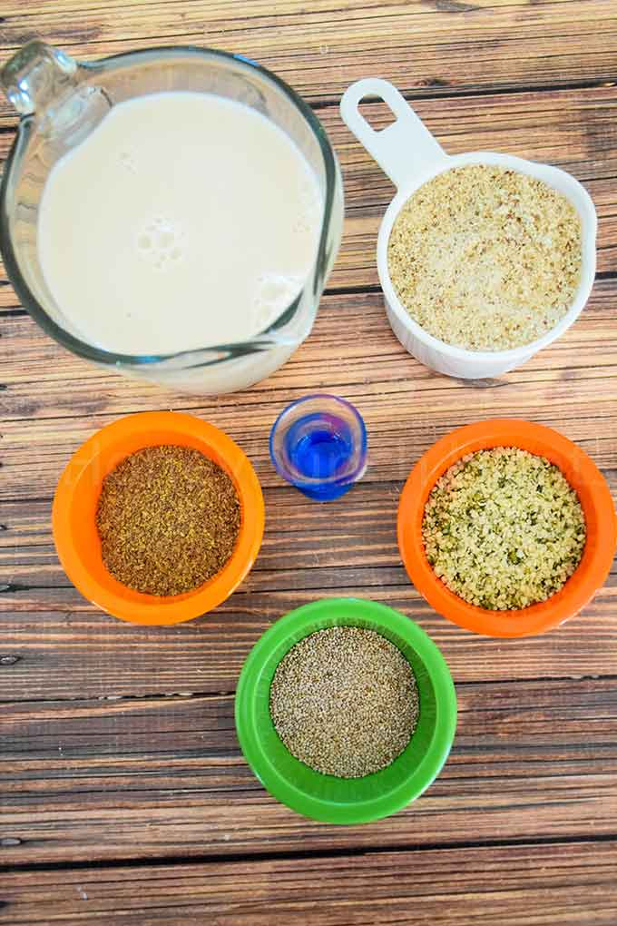 Ingredients for a grain free cereal, almond milk, almond meal, chia seed, hemp seed, flax seed, and banana extract