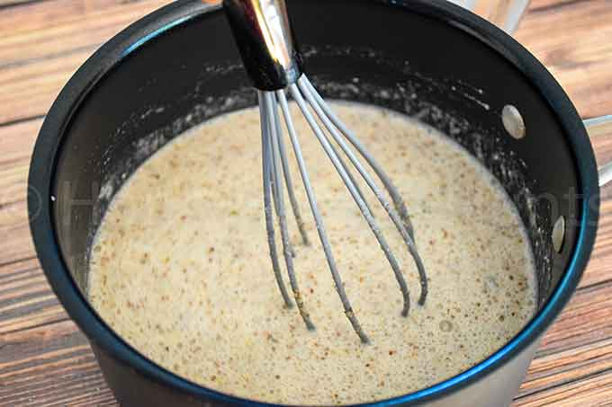 Ingredients for noatmeal in a saucepan