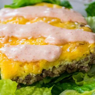 a serving of Big Mac Casserole on a bed of lettuce with mac sauce on top