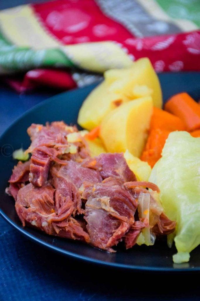 Boiled Ham Dinner on a black plate