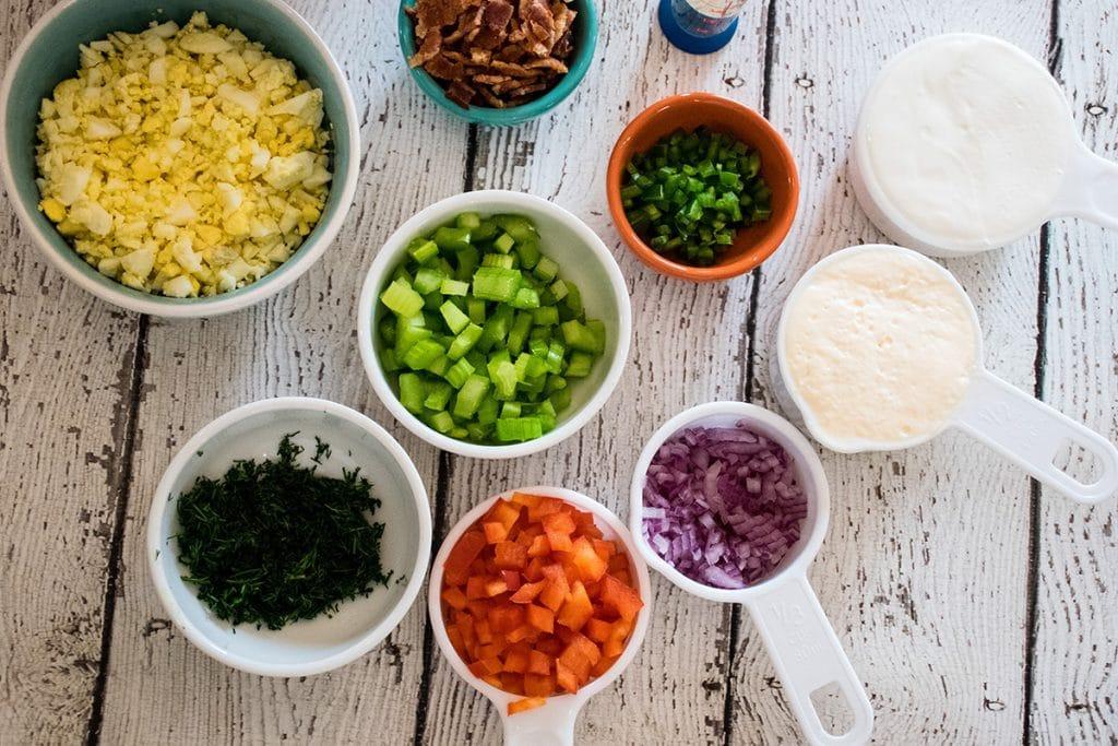 salad ingredients measured before assembling