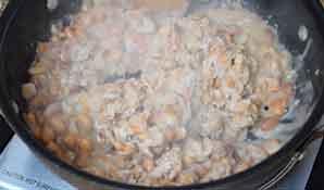beans simmering in skillet