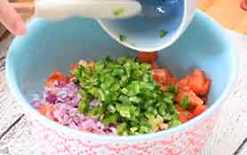 adding ingredients to bowl