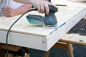 sanding plywood with hand sander