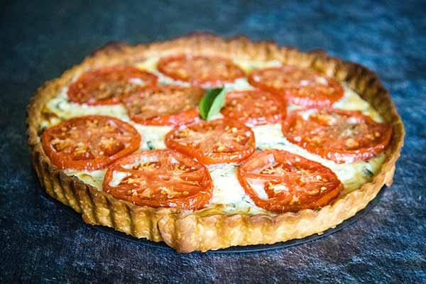 A whole uncut tomato tart