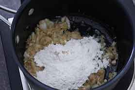 flour added to cooked onions in saucepan