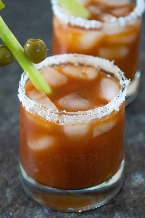 A bloody mary drink in a salt rimmed glass