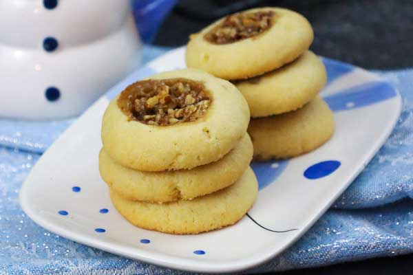 Pecan Pie Thumbprints Cookies on a cookie plate