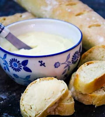 Salted Maple Butter Spread in a ceramic bowl with spreader and bread slices