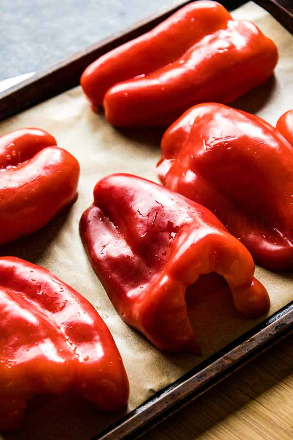 Red Peppers on a baking sheet lined with parchment paper