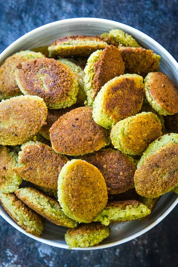 Overhead view of a bowl of cooked homemade falafel.