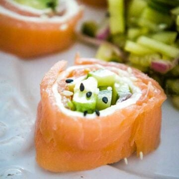 Salmon Sushi Rolls on a serving plate with cucumber relish