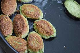 falafel frying in the skillet.