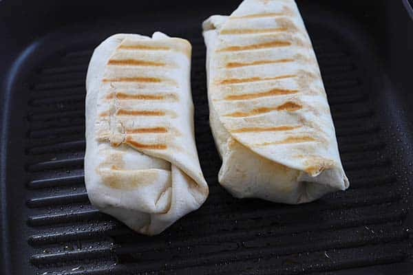 Breakfast Burritos cooking on the grill pan.