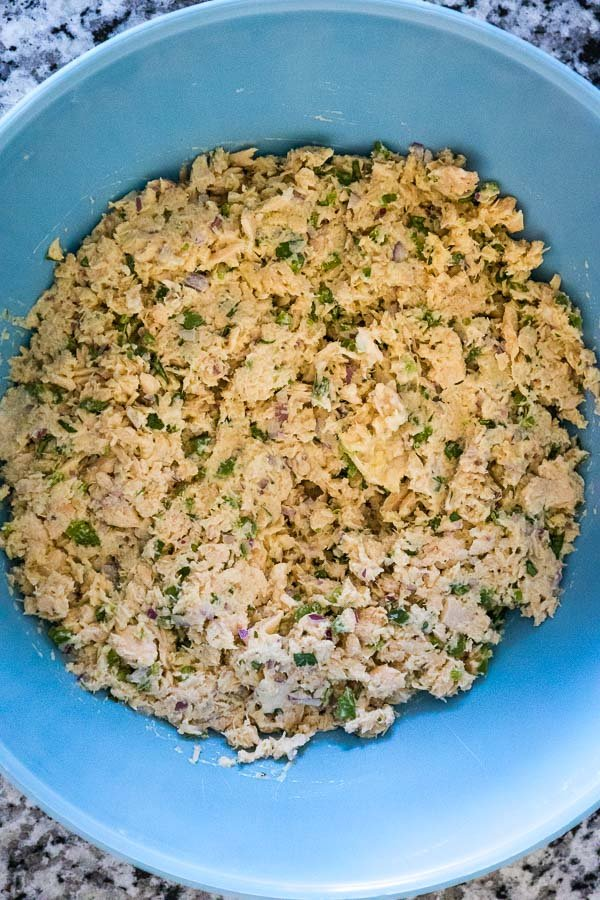 Salmon Patties mixture in a blue bowl ready to shape into patties.