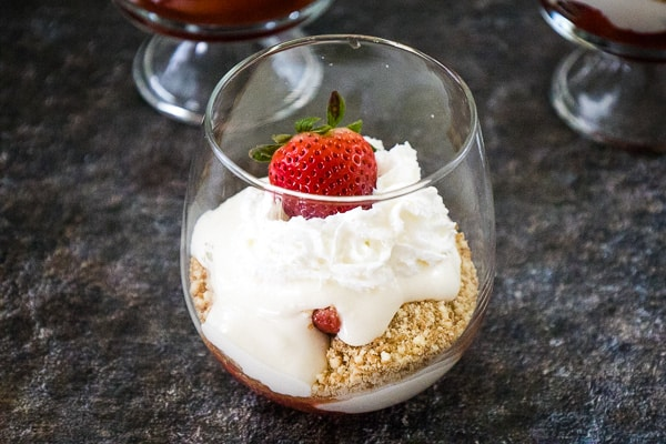 Strawberry Cheesecake Parfait in a stemless wine glass.