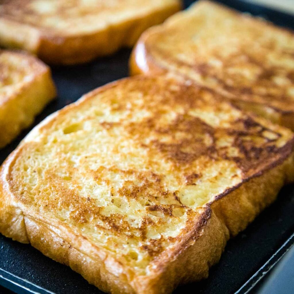 Browned french toast on the grill pan.