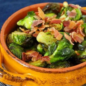Upclose image of air fryer brussels sprouts recipe in an orange serving bowl.