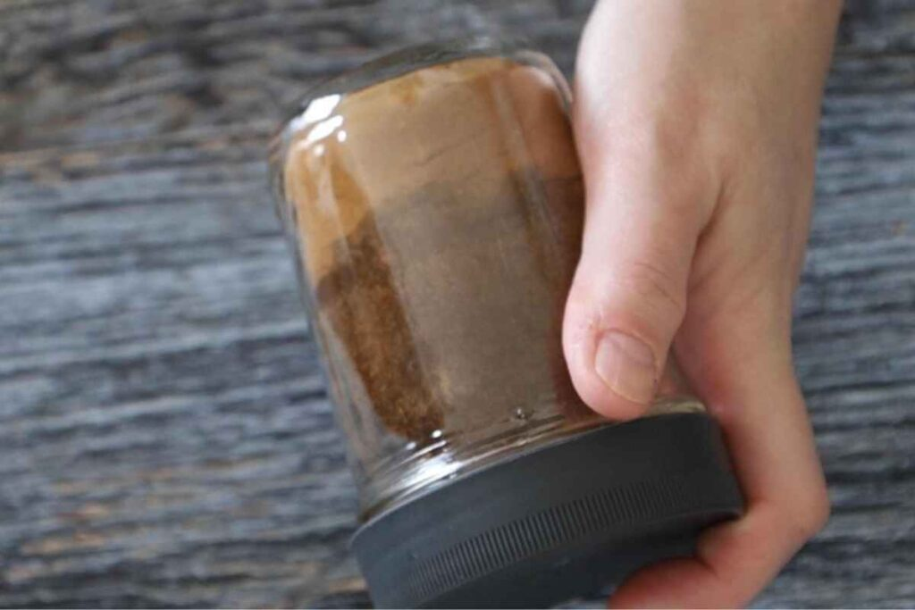 A sealed jar shaking the spices together to mix.